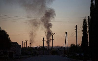 Smoke rises up after intense fighting between Syrian Army and FSA in a military base in Tal Sheen, Syria, on Saturday, December 15, 2012 (photo credit: AP Photo/Manu Brabo)