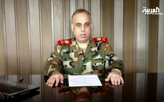 In this image made from video broadcast on Al Arabiya TV late Tuesday, Dec. 25, 2012, Syrian Maj. Gen. Abdul-Aziz Jassem al-Shallal says he is joining 'the people's revolution.'(photo credit: AP/Al Arabiya)