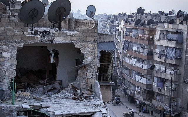 A destroyed building in Aleppo, Syria, on Thursday after airstrikes targeted the area. (photo credit: AP Photo/Narciso Contreras)