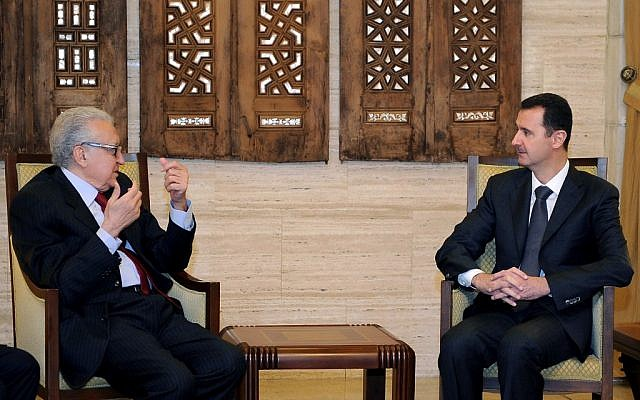 Syrian President Bashar Assad, right, meets with UN Arab League envoy to Syria, Lakhdar Brahimi, in Damascus on Monday, Dec. 24, 2012. (photo credit: SANA/AP)