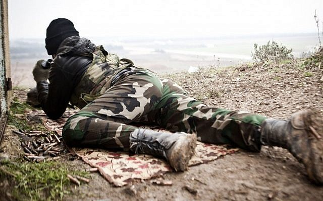 A Free Syrian Army fighter scans for Syrian Army positions in Azaz, Syria. (AP Photo/Virginie Nguyen Hoang)