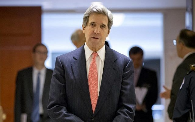 Secretary of State and former Senate Foreign Relations Chairman John Kerry leaves a closed-door briefing on the investigation of the deadly Sept. 11 attack on the US consulate in Benghazi last December. (photo credit: AP Photo/J. Scott Applewhite)