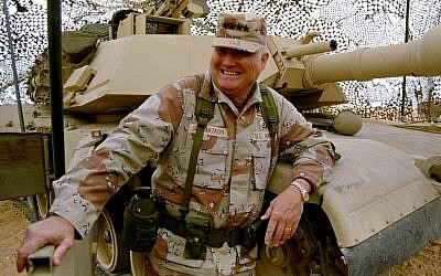 Gen. H. Norman Schwarzkopf stands at ease with his tank troops during Operation Desert Storm, on January 12, 1991, in Saudi Arabia. (photo credit: Bob Daugherty/AP)