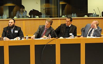 Religious activists and politicians including French Jewish leader Richard Prasquier (far right) and Rabbi Menachem Margolin (far left) discuss ritual slaughter in Poland December 2012 at the European Parliament. (Cnaan Liphshiz/JTA)