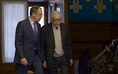 Russian Foreign Minister Sergey Lavrov, left, and UN envoy for Syria Lakhdar Brahimi talk during a meeting in Moscow, Russia, on Saturday, Dec. 29 (photo credit: AP/Ivan Sekretarev)