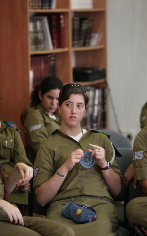 A soldier knitting during a class in the army (Photo credit: Ofir David courtesy of Aluma)