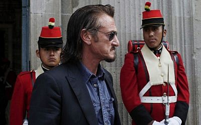 Actor Sean Penn leaves Bolivia's presidential palace after meeting with Evo Morales, whom he's pressed for Ostreicher's freedom. (Juan Karita/AP)