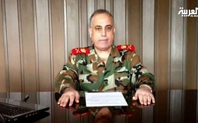 The former head of Syria's military police Maj. Gen. Abdul-Aziz Jassem al-Shallal announcing his defection to the rebels last December (photo credit: screen capture/Al-Arabiya)