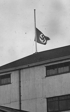 Despite its large Jewish fan base, the Tottenham Hotspur soccer club raised a swastika above its home field for a 1935 game against Germany. (Popperfoto/Getty Images)
