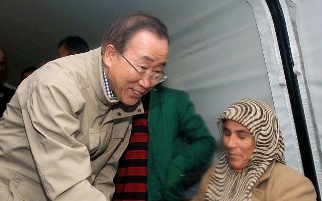 UN chief Ban Ki-moon visits Syrian refugees at a camp in Islahiye, near the Syrian border, in Turkey, Friday. (photo credit: AP Photo/Veli Gurgah)