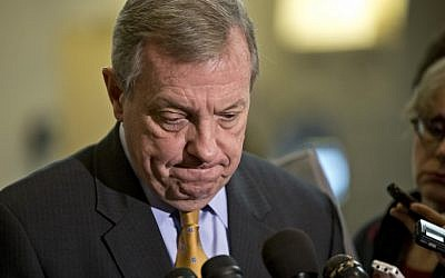 Senator Dick Durbin, D-Ill., a member of the Senate Foreign Relations Committee, pauses as he speaks to reporters following a closed-door briefing on the investigation of the deadly Sept. 11 attack on the U.S. consulate in Benghazi, Libya, at the Capitol in Washington, Wednesday, Dec. 19, 2012. (photo credit: AP/J. Scott Applewhite)