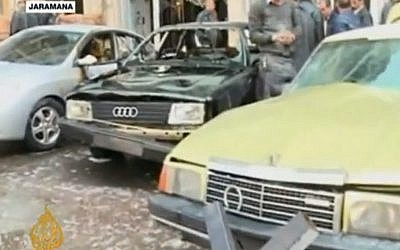 Cars harmed by an explosion in Damascus, Wednesday (photo credit: screen capture AlJazeeraEnglish/Youtube)