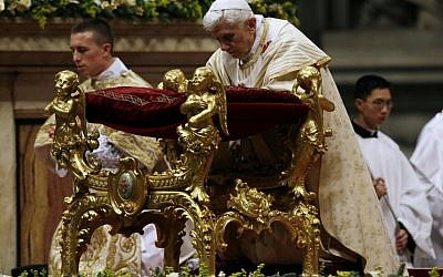 Pope Benedict XVI kneels as he celebrates the Christmas Eve Mass in St. Peter's Basilica at the Vatican on Monday, Dec. 24, 2012. (photo credit: Gregorio Borgia/AP)