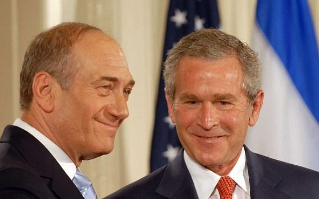 Then-US president George W. Bush welcomes then-prime minister Ehud Olmert to the Oval Office of the White House in Washington in May of 2006. (photo credit: Avi Ohayon/GPO/Flash90)