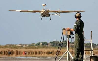 A soldier brings a 'Searcher II' UAV down for a landing after returning from a reconnaissance mission. (photo credit: Tsahi Ben-Ami/Flash90)