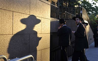 Illustrative photo of ultra-Orthodox men in Brooklyn's Jewish community, New York, (Serge Attal/Flash90)