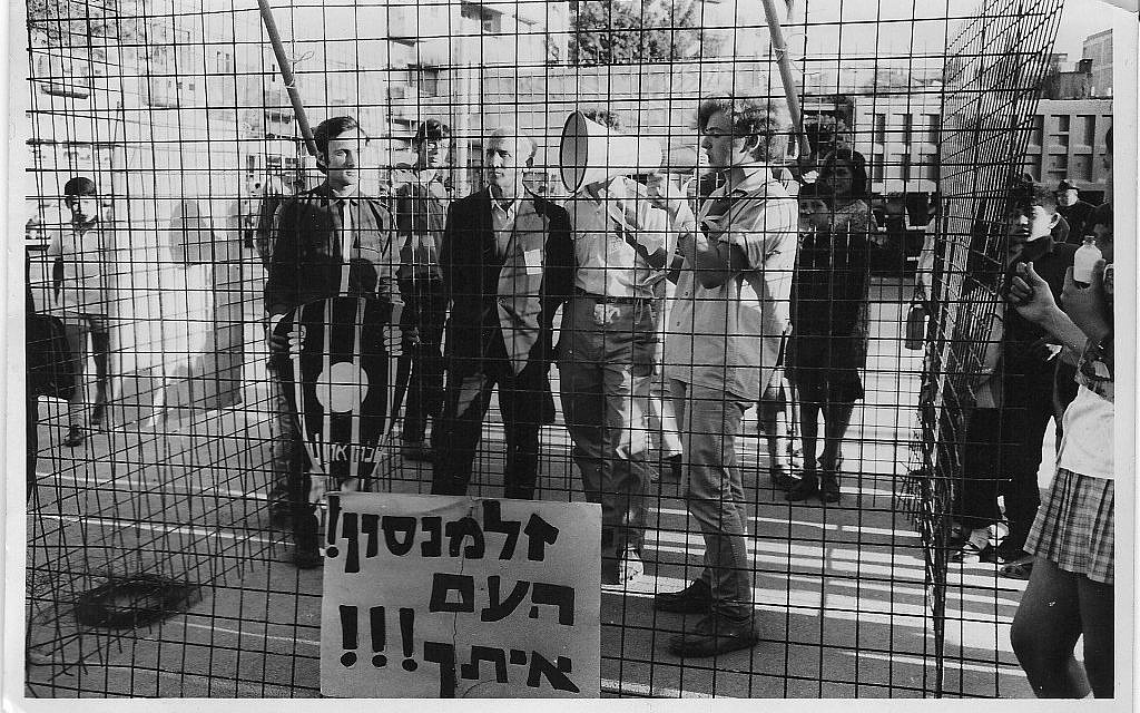 "Israeli activists dramatize Sylva Zalmanson's imprisonment in the Soviet Union by protesting in a cage with a sign that reads, ""Zalmanson, the people are with you."" (Courtesy of Anat Kuznetzov-Zalmanson)"
