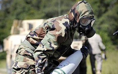 US soldiers train for chemical warfare (photo credit: Marv Lynchard/US Department of Defense/File)