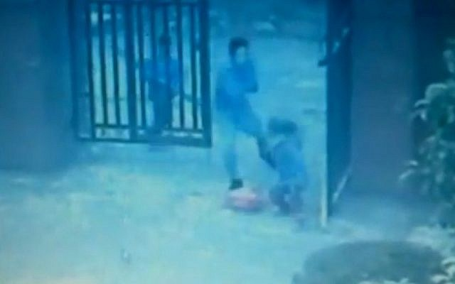 An assailant lashes out at a child in this grainy video footage released by the Chinese authorities from last week's school attack (photo credit: YouTube screenshot)