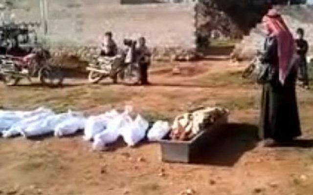 A mass burial in Syria on Saturday from a video uploaded by the Local Coordination Committees (photo credit: screen capture/Youtube)