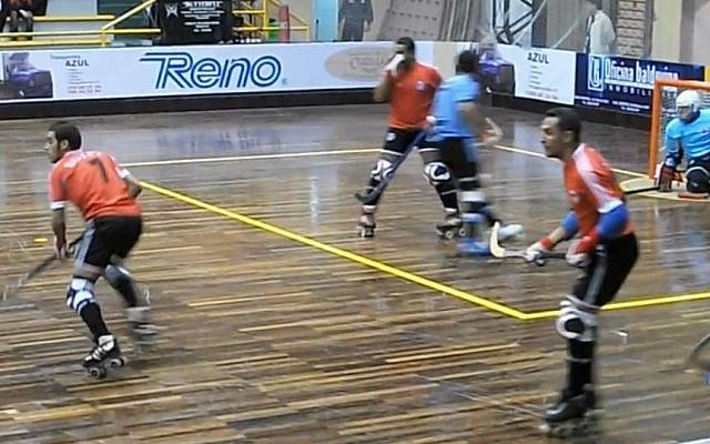 Egyptian roller hockey players (in orange) playing in the B-World Cup in Uruguay last week. (photo credit: image capture from YouTube video uploaded by mdario6887)