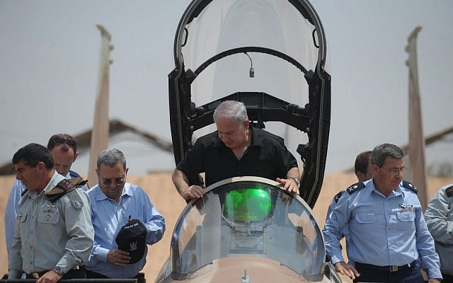 Benjamin Netanyahu sits in the cockpit of a F-15 fighter jet at Hatzerim Air Base in southern Israel in August 2009. (Israel Defense Forces /Flash90)