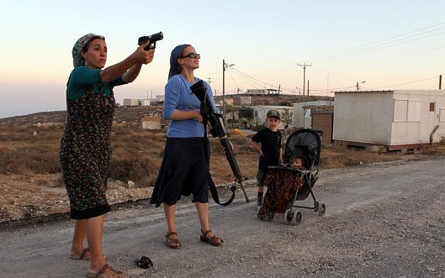 Female Jewish settlers practice firing weapons at the Jewish settlement of Pnei Kedem, near the West Bank city of Bethlehem, in September. (photo credit: Nati Shohat/Flash90)