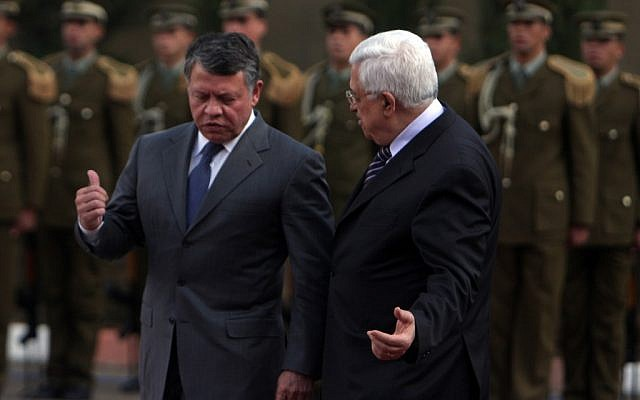 Palestinian Authority President Mahmoud Abbas (right) and King Abdullah II of Jordan during a welcoming ceremony in Ramallah in 2011 (photo credit: Issam Rimawi/Flash90)