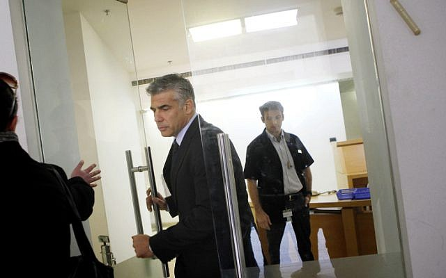 Yair Lapid, head of the Yesh Atid political party, leaves the High Court in Jerusalem after filing a petition to halt the Israeli government's decision to substitute national service for military service for 1,300 members of the ultra Orthodox Jewish community. December 10, 2012.  (photo credit: Miriam Alster/FLASH90)