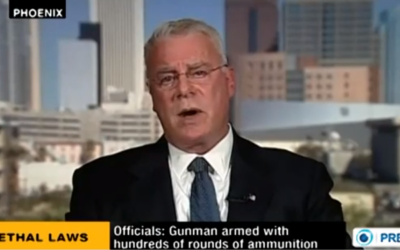 Michael Harris speaks on Iranian Press TV. (photo credit: image capture from YouTube video uploaded by Press TV)