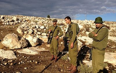 Lt. Col. Hassan, left, teaching a young tracker the ropes (Photo credit: Mitch Ginsburg/ Times of Israel)