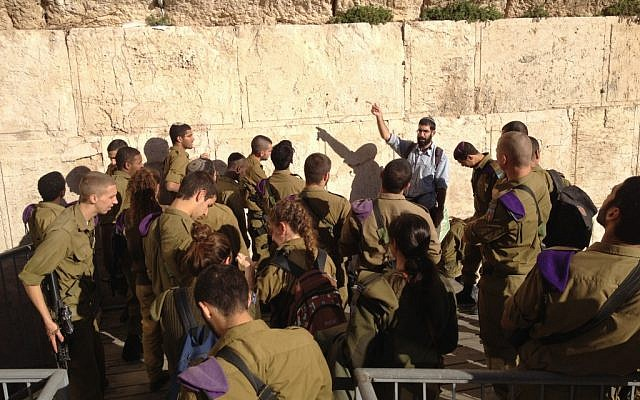 David Kohelet speaking to the soldiers just beneath the Mughrabi Gate to the Temple Mount (Photo credit: Mitch Ginsburg/ Times of Israel)