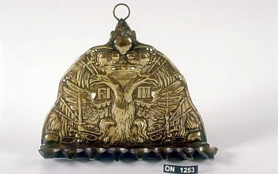 The menorah was fashioned, apparently in Italy, from a plate that once adorned the hat of an Austro-Hungarian soldier (Courtesy of the U. Nahon Museum of Italian Jewish Art)