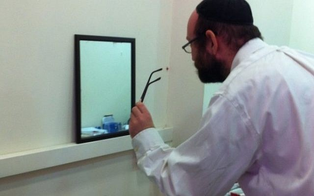 A man tries on a pair of glasses at IsraelOptical's pop-up store in the Rav Shefa Mall (Photo credit: Courtesy)