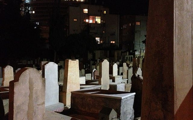 A view of the gravesites in Tel Aviv's Trumpeldor cemetery (photo credit: Jessica Steinberg/Times of Israel)