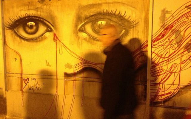 One of the wall murals painted by visiting UK street artist My Dog Sighs (photo credit: Jessica Steinberg/Times of Israel))