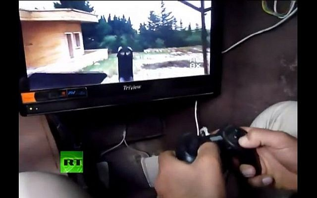 Inside the Syrian rebel armored vehicle (photo credit: screen capture Russia Today/Youtube)