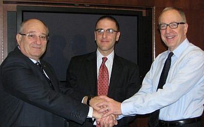(L. to R.) Cornell University President David J. Skorton, New York City Economic Development Corporation President Seth Pinsky, and Technion President Peretz Lavie shake hands after signing documents establishing the Cornell-Technion center (Photo credit: Courtesy)