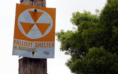 A sign pointing at a nuclear shelter (illustrative photo credit: CC-BY-SA un_cola/Flickr)