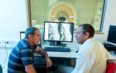 Alon Friedman (left) and Ilan Shelef with the MRI machine on Sunday (photo credit: courtesy of Dani Machlis/BGU)