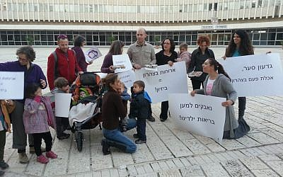 Members of 'Aruchat Eser' protesting unhealthy school lunches by presenting trays of food to Education Ministry staffers (photo credit: Marik Stern)