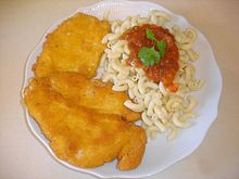 Schnitzel and orzo (or in this case, pasta), is often the carb-filled lunch of choice at Israeli schools (photo credit: Aviad Bublil/CCA-SA)