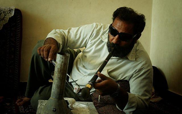 An Iranian man smoking opium in Kerman, Iran. (CC BY-SA hypertornado, Flickr)