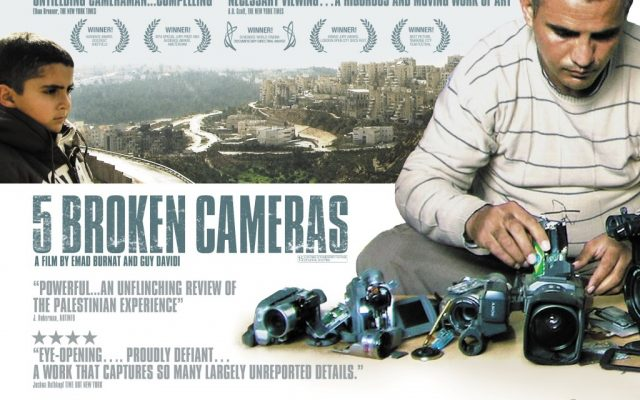 Emad Burnat and one of his sons in the movie poster for '5 Broken Cameras' (Courtesy '5 Broken Cameras')