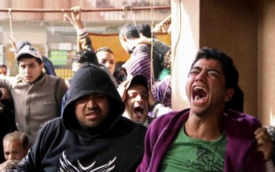Families and supporters of those accused of soccer violence from the Port Said soccer club react to the announcement of verdicts for 21 fans on trial in last years Port Said stadium incident which left 74 people dead, in Port Said, Egypt, Saturday, Jan. 26, 2013 (photo credit: AP/Mohammed Nouhan)