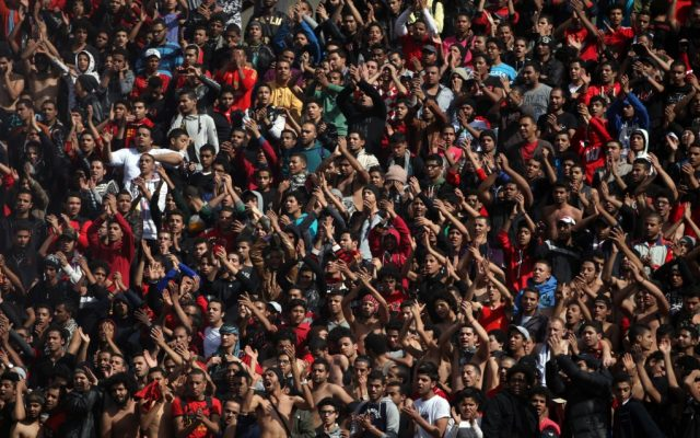 Egyptian soccer fans of the Al-Ahly club celebrate a court verdict that returned 21 death penalties in last year's soccer violence which left 74 dead, inside the club premises in Cairo, Egypt, Saturday, January 26, 2013 (photo credit: AP/Khalil Hamra)