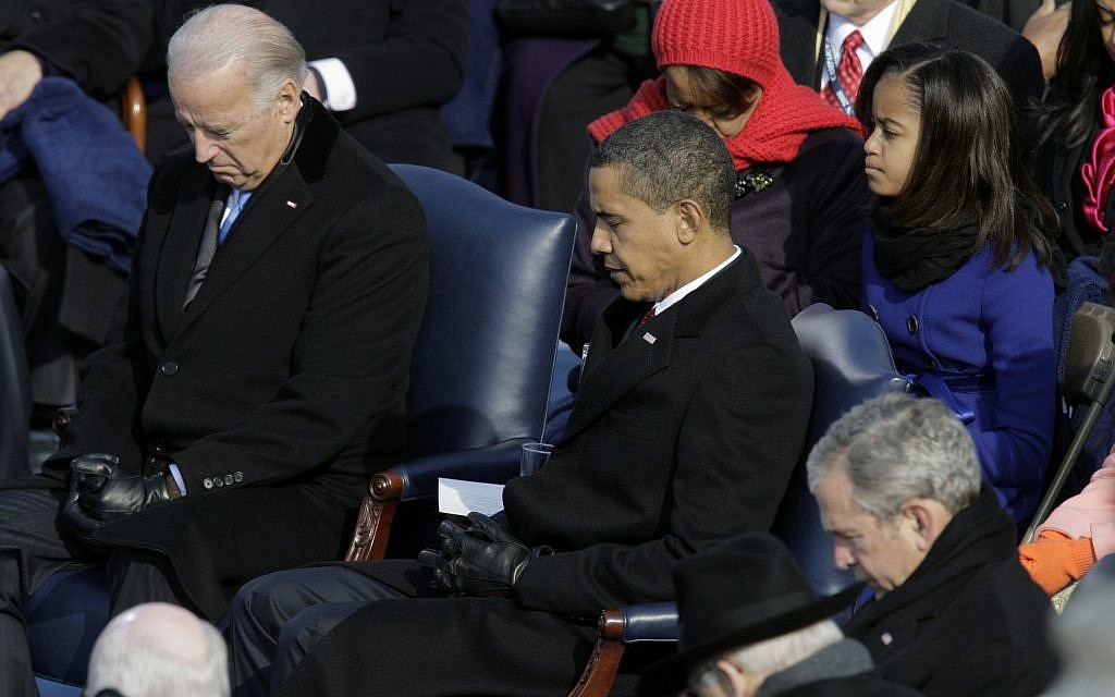 Vice President-elect Joe Biden, President-elect Barack Obama and President George W. Bush, left to right, bow their heads during the invocation at the beginning of the swearing-in ceremony at the U.S. Capitol in Washington, Tuesday, Jan. 20, 2009 (photo credit: AP/Jae C. Hong)