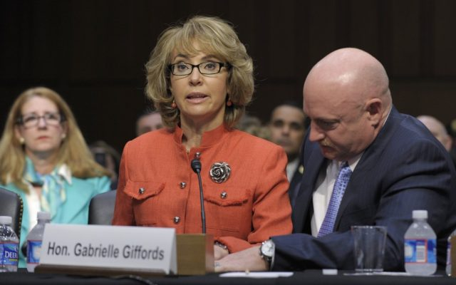 Former Arizona Rep. Gabrielle Giffords, who was seriously injured in the mass shooting that killed six people in Tucson, Ariz. two years ago, sits with her husband Mark Kelly, and speaks on Capitol Hill in Washington, Wednesday, Jan. 30, 2013, before the Senate Judiciary Committee hearing on gun violence. (photo credit: AP/Susan Walsh)