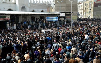 Egyptians carry the coffin of a man killed during a mass funeral in Port Said, Egypt, Sunday, January 27, 2013. Tens of thousands of mourners poured into the streets of the restive Egyptian city of Port Said on Sunday for a funeral for most of the 37 people killed in rioting a day earlier, chanting slogans against Islamist President Mohammed Morsi. (photo credit: AP)