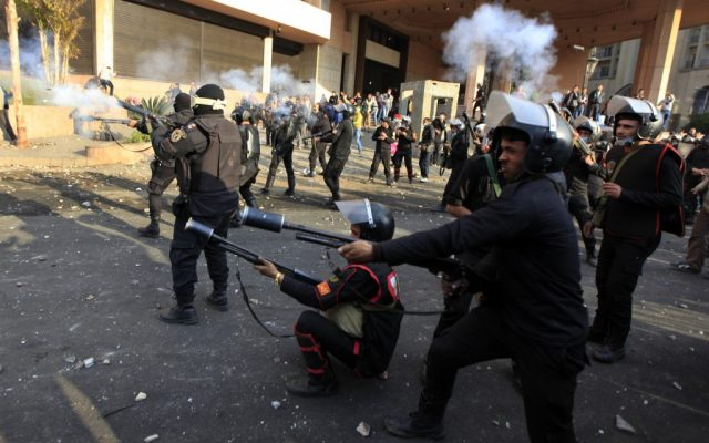 Egyptian riot police fire tear gas at unseen protesters during clashes in front of the Semiramis Intercontinental Hotel, near Tahrir Square, Cairo, Egypt, Tuesday, January 29, 2013. (photo credit: AP/Khalil Hamra)